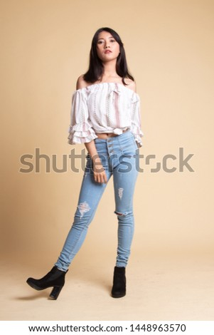 Full body of beautiful young asian woman  on beige background #1448963570