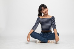 Full body of  beautiful young Asian woman  sit on floor  on white background