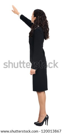 Full body of young business woman pointing at something in her back, isolated over white background