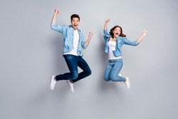 Full body photo of attractive lady handsome funny guy crazy fan jumping high up celebrating football team winning wear casual denim shirts outfit isolated grey color background