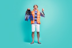Full body photo of funny aged seaman underwater breathing equipment flippers tube mask diver wear striped sailor shirt shorts orange life vest flip-flops isolated teal color background