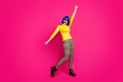 Full body photo of funny lady dancing moves students theme party wear specs yellow turtleneck blue bob wig boots leopard trousers isolated vivid pink color background
