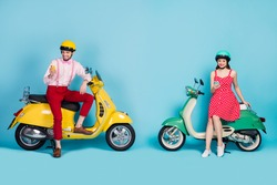 Full body photo of funny lady guy two people sitting vintage moped vacation together short stop browsing telephones bloggers wear retro clothes headgear isolated blue color background