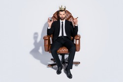 Full body photo of handsome business guy sit office chair hold whiskey glass cuban cigar luxury chief golden crown wear black blazer pants tie shirt shoes suit isolated grey background