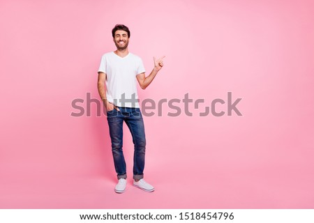 Full body photo of positive cheerful middle eastern man point index finger copyspace show ads promo discounts wear trend modern imposing outfit isolated over pastel color background