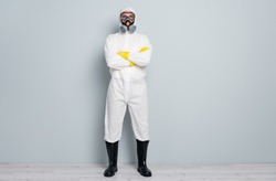 Full body photo of professional guy disinfectant watch public places disinfection arms crossed wear white hazmat protective suit goggles mask gloves gumboots isolated grey color background