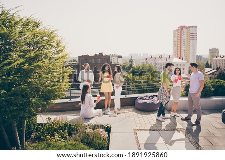 Full body photo of young friends gathered together have fun enjoy chill rooftop party drink chat communicate Stock photo ©