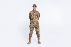 Full body photo of young woman confident soldier officer army camouflage uniform isolated over white color background