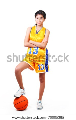 full body picture of a beautiful basketball player standing over a ball.white background