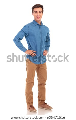 full body picture of a casual man with hands on waist on white background
