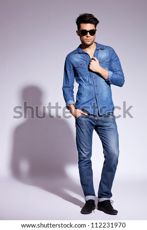 full body picture of a fashion young man wearing sunglasses