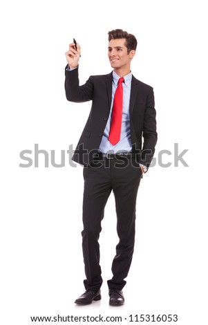 full body picture of a smiling business man writing something with a marker
