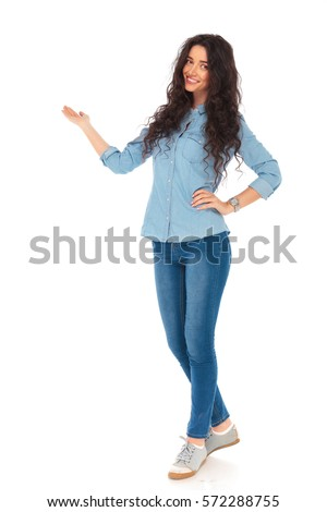 full body picture of a smiling casual woman presenting something on white background