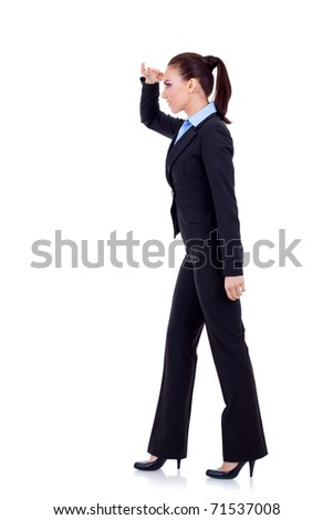 full body picture of a young business woman looking forward over white