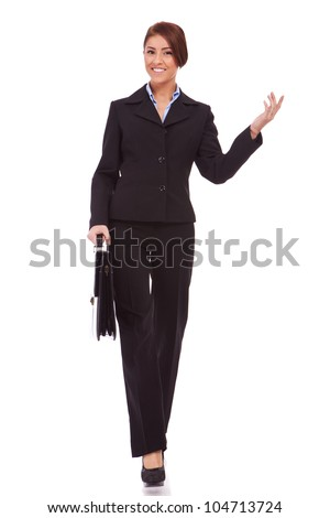 full body picture  of successful business woman walking with a briefcase and welcoming - White background - stock photo