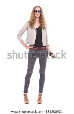 Full body portrait of a beautiful woman in sunglasses posing