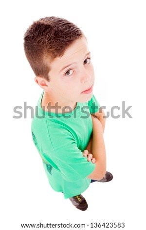 Full body portrait of a little boy looking up against white background