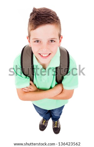 Full body portrait of a school boy with backpack, isolated on white background