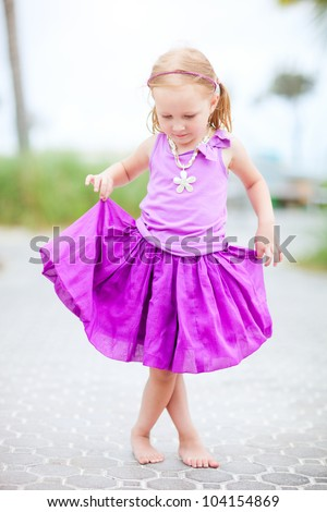 Full body portrait of adorable little girl outdoors - stock photo