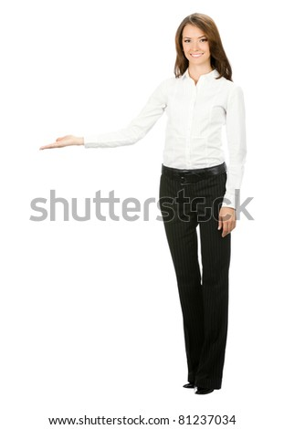 Full body portrait of happy smiling beautiful young cheerful business woma showing something, isolated on white background