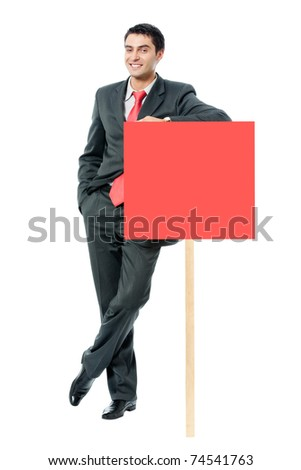 Full body portrait of happy smiling businessman showing red signboard, isolated on white background