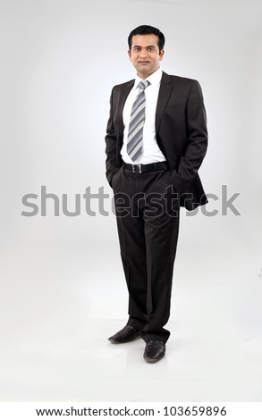 Full body portrait of happy smiling indian business man - stock photo