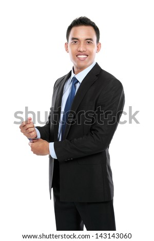 Full body portrait of happy smiling young businessman isolated on white background #143143060
