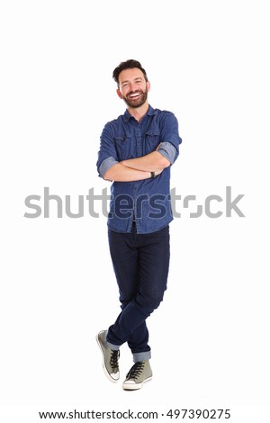 Full body portrait of relaxed mature man standing with arms crossed over white background