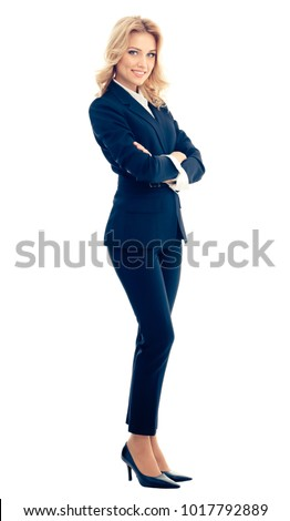 Full body portrait of smiling beautiful young businesswoman, isolated over white background. Caucasian blond model in business success concept. stock photo