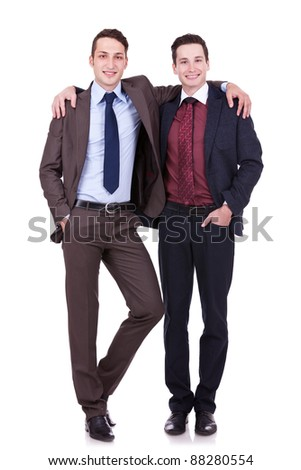 full body portrait of two friendly business men on white background - stock photo