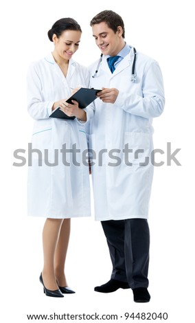Full body portrait of two happy smiling young medical people with clipboard, isolated over white background