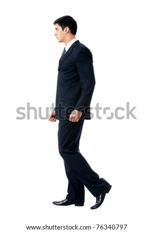 8aea8dd9884 Full body portrait of walking young business man