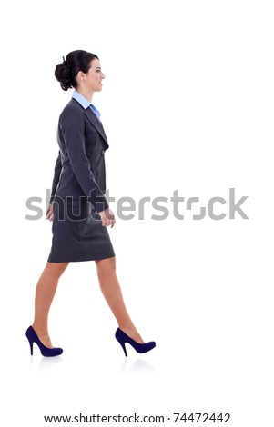 Full body portrait of walking business woman, isolated on white