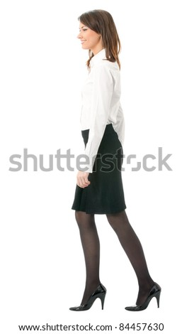 Full body portrait of walking business woman, isolated on white background