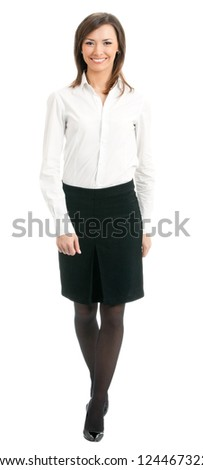 Full body portrait of walking business woman, isolated over white background
