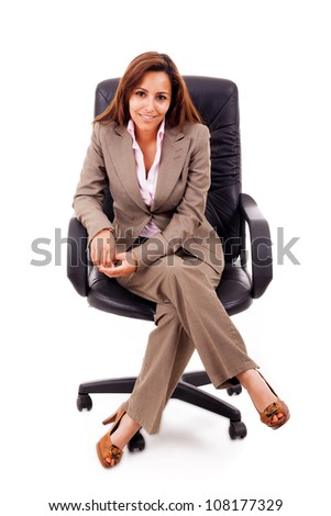Full body portrait of young business woman sitting on the chair over white background