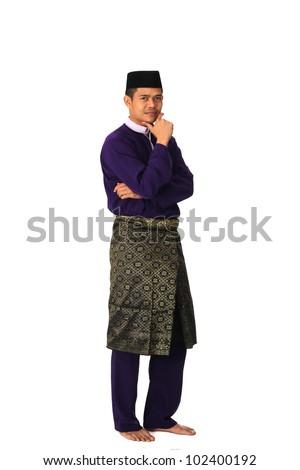 Full body portrait of young muslim with malaysia traditional  baju melayu isolated on white