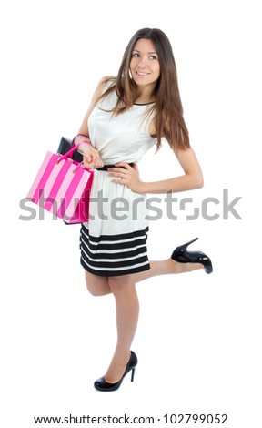 Full body pretty woman shopping bags after successful shopping, smiling and looking at the camera on a white background - stock photo