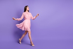 Full body profile photo of cheerful person walking wear retro stilettos isolated on purple color background