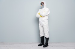 Full body profile photo of professional disinfectant watch check control public places disinfection arms crossed wear hazmat protective suit goggles mask boots isolated grey color background