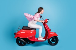 Full body profile portrait of astonished lady speedy drive bike nice journey open mouth isolated on blue color background