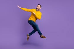 Full body profile portrait of energetic man look empty space arms dabbing isolated on purple color background