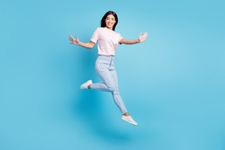 Full body profile side photo of young asian girl happy positive smile have fun jump isolated over blue color background