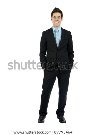 Full body shot of a smiling dashing handsome young man in his business suit with hands in pocket, isolated on white background.