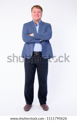 Full body shot of happy overweight businessman smiling with arms crossed Сток-фото ©