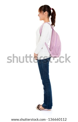 Full body side view of Asian female young adult student standing isolated on white background