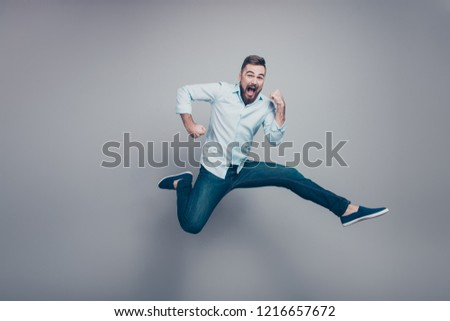 Full body size length studio photo portrait of crazy mad optimistic positive guy with open mouth looking at camera isolated gray background copy space #1216657672
