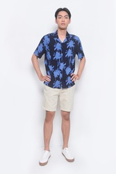 Full body Summer man casual wearing new stylish coconut tree printed shorts sleeve shirts with white shorts pants and sneakers