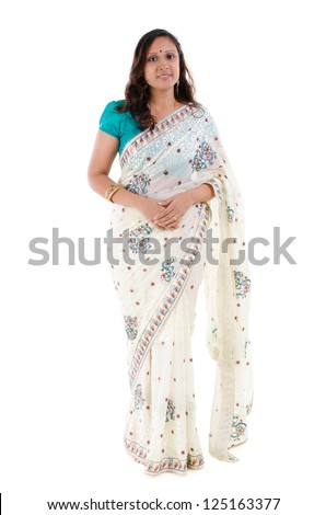 Full body traditional Indian woman in sari costume standing isolated on white background