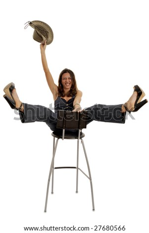 Full body view of funny young woman in cowboy wear, riding a high stool. Isolated on white background.